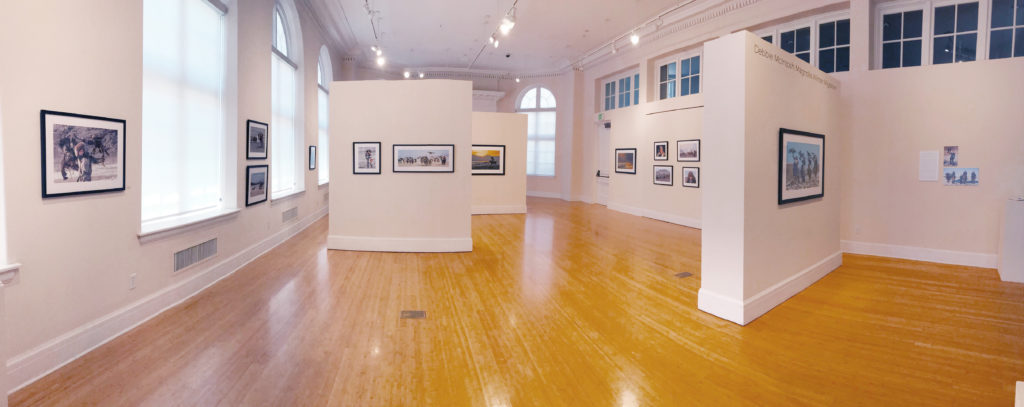 East Oregonian Gallery with color photos on the walls and large expanse of floor.