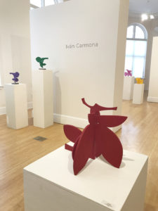 large red sculpture that references the contours of plants