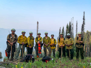 Nine Wildland Firefighters on a ridgeline